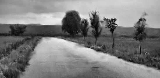 Obraz Krajina za sklem v dešti